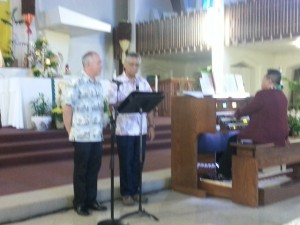 Left to right, Fr. Ed Popish and Fr. Lane Akiona lead Hawaiian hymns